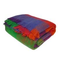 Farbenfrohe Mohair Wohlfühldecke in vielen bunten Farben mit Fransen.